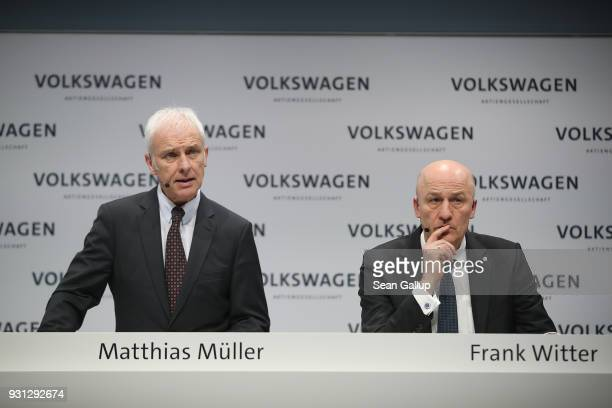 Matthias Mueller Chairman of German automaker Volkswagen AG and VW Chief Financial Officer Frank Witter attend the company's annual press conference...