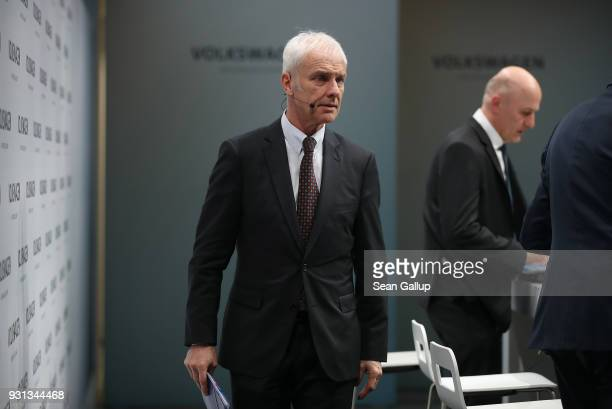 Matthias Mueller Chairman of German automaker Volkswagen AG departs after attending the company's annual press conference on March 13 2018 in Berlin...
