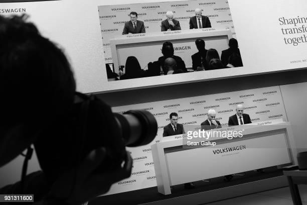 Matthias Mueller Chairman of German automaker Volkswagen AG VW Chief Financial Officer Frank Witter and Communications Director HansGerde Bode attend...
