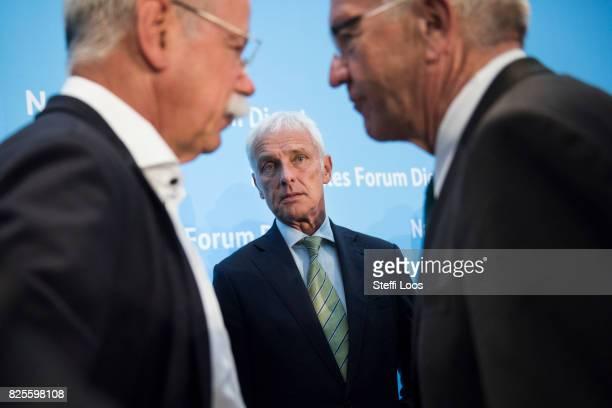 Matthias Mueller Chairman of Volkswagen AG Dieter Zetsche chairman of German car maker Daimler AG and Governor of BadenWuerttemberg Winfried...