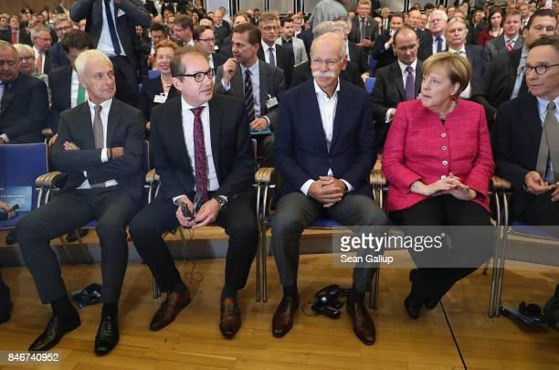 Matthias Mueller Chairman of Volkswagen AG German Transport Minister Alexander Dobrindt Dieter Zetsche Chairman of Daimler AG and German Chancellor...