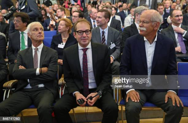 Matthias Mueller Chairman of Volkswagen AG German Transport Minister Alexander Dobrindt and Dieter Zetsche Chairman of Daimler AG attend the opening...