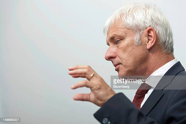 Matthias Mueller chief executive officer of Porsche AG gestures during an interview at the company's headquarters in Stuttgart Germany on Friday June...