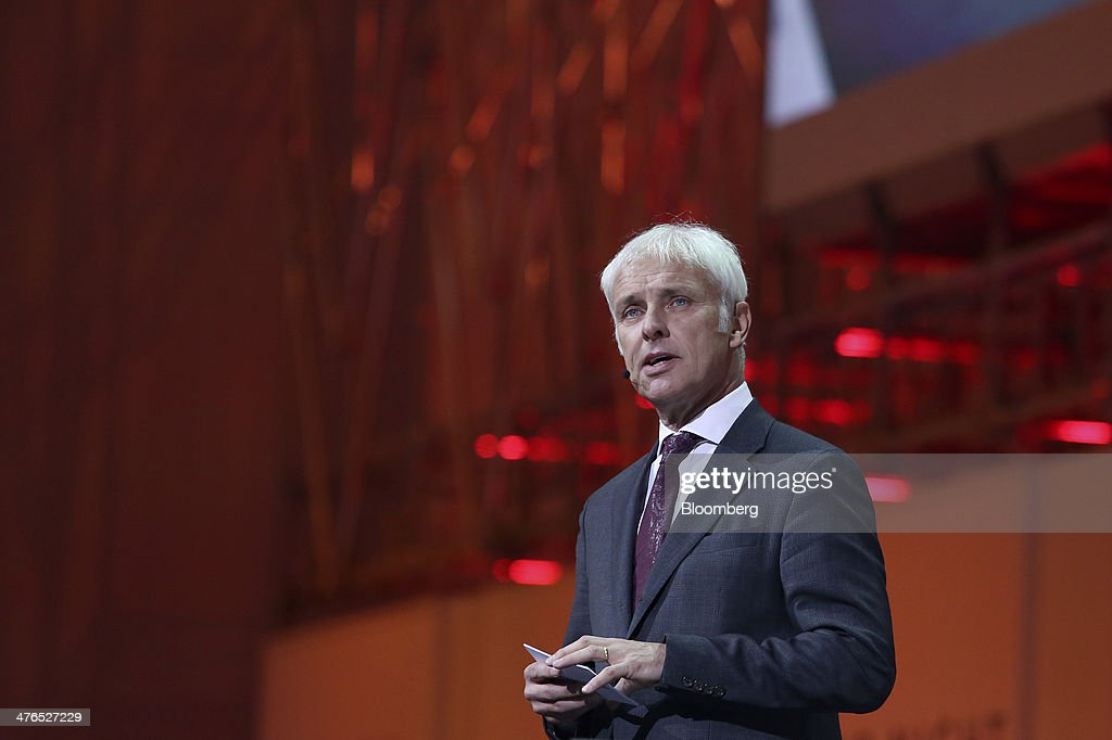 Matthias Mueller, chief executive officer of Porsche AG, left, introduces the new Porsche 918 Spyder automobile, produced by Porsche SE, during a news conference ahead of the opening day of the 84th Geneva International Motor Show in Geneva, Switzerland, on Monday, March 3, 2014. The International Geneva Motor Show will run from Mar. 4, and showcase the latest models from the world's top automakers. Photographer: Chris Ratcliffe/Bloomberg via Getty Images