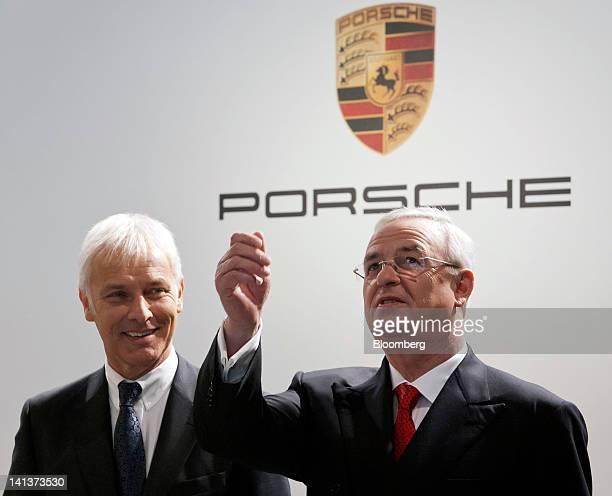 Matthias Mueller chief executive officer of Porsche SE left stands with Martin Winterkorn chief executive officer of Volkswagen AG ahead of the...