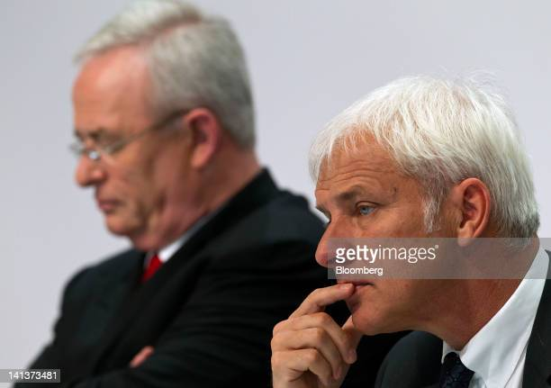 Matthias Mueller chief executive officer of Porsche SE rights pauses as he sits with Martin Winterkorn chief executive officer of Volkswagen AG...