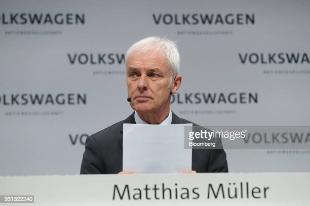 Matthias Mueller chief executive officer of Volkswagen AG holds a document during a news conference at the automaker's annual media conference in...