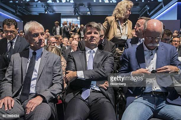Matthias Mueller chief executive officer of Volkswagen AG left and Harald Krueger chief executive officer of Bayerische Motoren Werke AG center look...