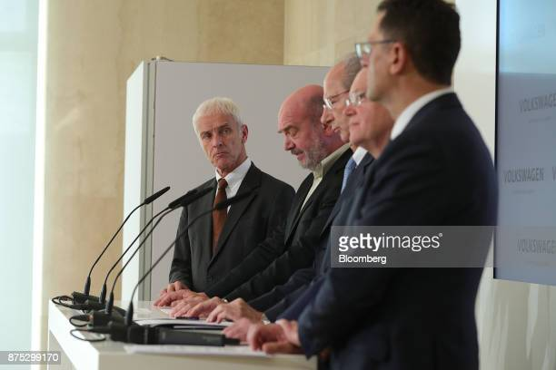 Matthias Mueller chief executive officer of Volkswagen AG left look on during a news conference at the automaker's headquarters in Wolfsburg Germany...