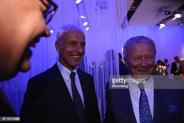 Matthias Mueller chief executive officer of Volkswagen AG left reacts as he stands with Wolfgang Porsche chairman of Porsche SE during the Volkswagen...