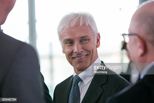Matthias Mueller chief executive officer of Volkswagen AG reacts following a news conference to announce the company's fourth quarter earnings at the...