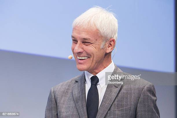 Matthias Mueller chief executive officer of Volkswagen AG reacts during a panel discussion at the Handlesblatt Automotive Summit in Munich Germany on...