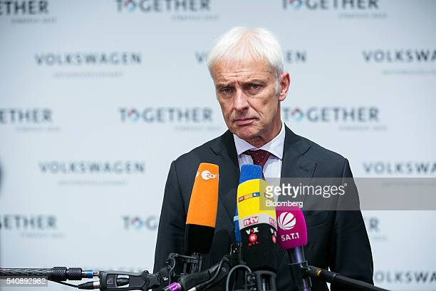 Matthias Mueller chief executive officer of Volkswagen AG speaks to television crews after making a new strategy announcement at the automaker's...