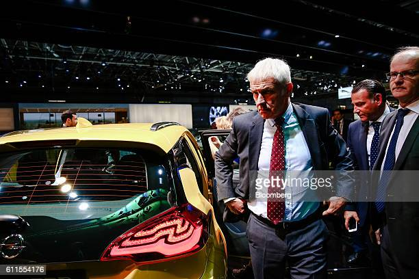 Matthias Mueller, chief executive officer of Volkswagen AG, stands beside a Opel AG Ampera-e electric automobile on the second press day of the Paris...