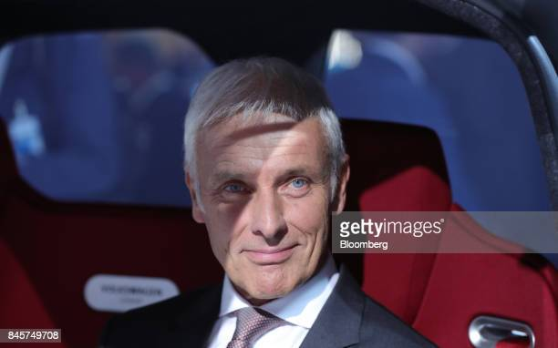 Matthias Mueller chief executive officers of Volkswagen AG sits for a photograph inside a VW Sedric concept electric autonomous robotaxi at the VW...