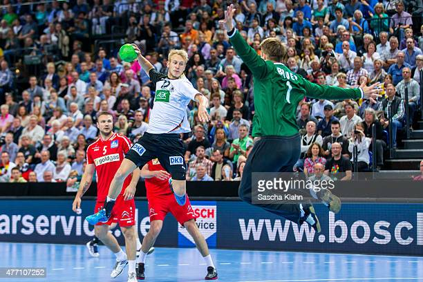 Matthias Musche of Germany challenges goalkeeper Thomas Bauer of Austria during the European Handball Championship 2016 Qualifier between Germany and...