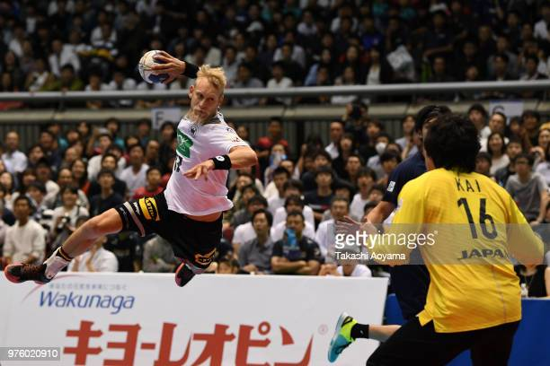 Matthias Musche of Germany jumps to shoot at goal during the handball international match between Japan and Germany at the Tokyo Metropolitan...