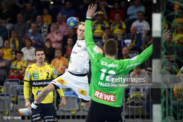 Matthias Musche of Magdeburg tries to score against goalkeeper Andreas Palicka of RheinNeckar Loewen during the DKB HBL match between RN Loewen and...