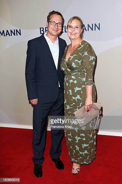 Matthias Opdenhoevel and his wife Alexandra Opdenhoevel attend the Bertelsmann Summer Reception on September 27 2012 in Berlin Germany