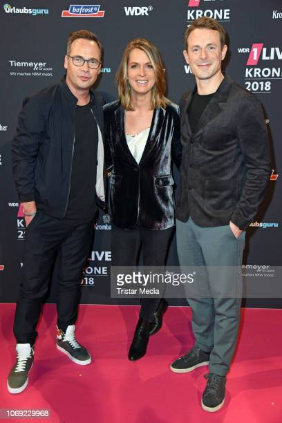 Matthias Opdenhoevel Jessy Wellmer and Alexander Bommes arrive at the 1Live Krone radio award red carpet at Jahrhunderthalle on December 6 2018 in...