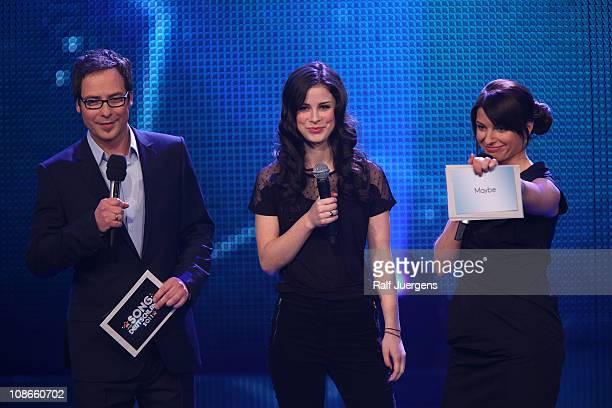 Matthias Opdenhoevel Lena MeyerLandrut and Sabine Heinrich perform during the TV show 'Unser Song fuer Deutschland' on January 31 2011 in Cologne...