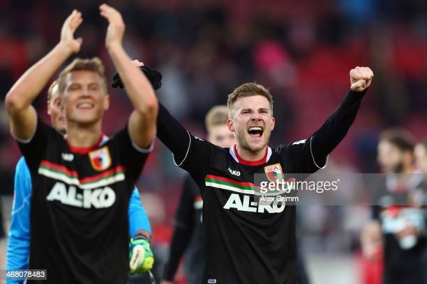 Matthias Ostrzolek and Daniel Baier of Augsburg celebrate after the Bundesliga match between VfB Stuttgart and FC Augsburg at MercedesBenz Arena on...