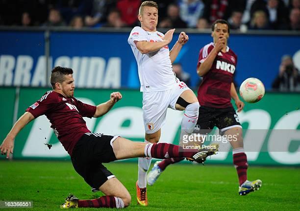 Matthias Ostrzolek of Augsburg challenges Marvin Plattenhardt of Nuernberg during the Bundesliga match between FC Augsburg and 1 FC Nuernberg at SGL...