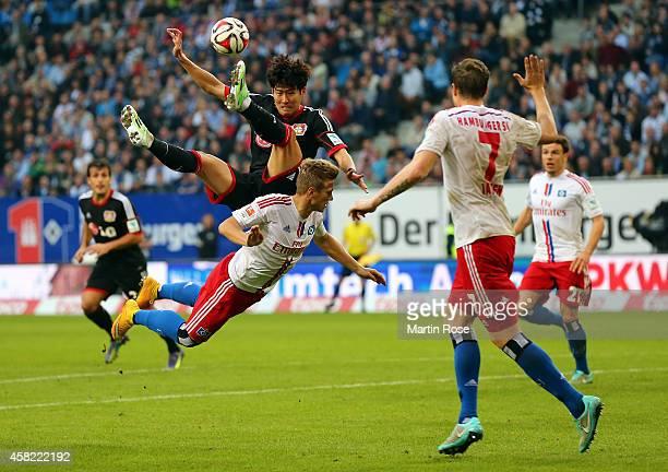 Matthias Ostrzolek of Hamburg and Heung Min Son of Leverkusen battle for the ball during the Bundesliga match between Hamburger SV and Bayer 04...