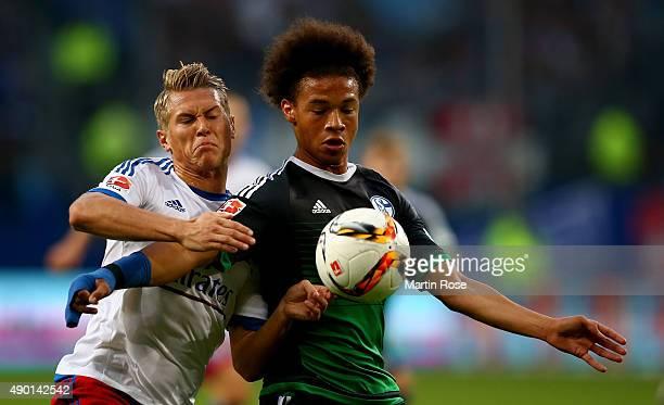 Matthias Ostrzolek of Hamburg and Leroy Sane of Schalke battle for the ball during the Bundesliga match between Hamburger SV and FC Schalke 04 at...