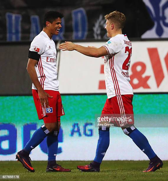 Matthias Ostrzolek of Hamburg celebrates scoring the second goal with Douglas Santos during the Bundesliga match between SV Darmstadt 98 and...