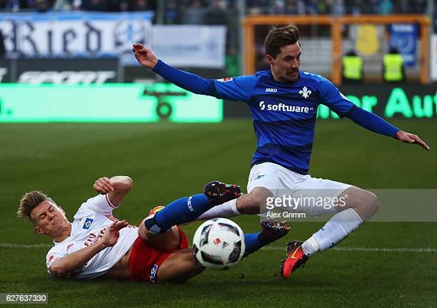 Matthias Ostrzolek of Hamburg challenges Sandro Sirigu of Darmstadt during the Bundesliga match between SV Darmstadt 98 and Hamburger SV at Stadion...