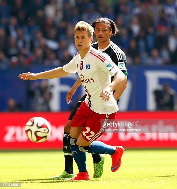 Matthias Ostrzolek of Hamburg is challenged by Leroy Sane of Schalke during the Bundeslga match between Hamburger SV and FC Schalke 04 at Imtech...