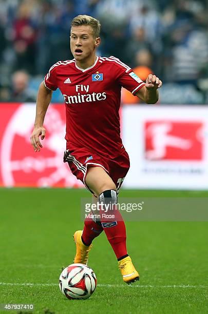 Matthias Ostrzolek of Hamburg runs with the ball during the Bundesliga match between Hertha BSC and Hamburger SV at Olympiastadion on October 25 2014...