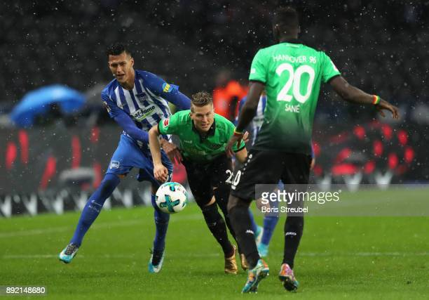 Matthias Ostrzolek of Hannover 96 is challenged by Davie Selke of Hertha BSC during the Bundesliga match between Hertha BSC and Hannover 96 at...