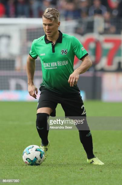 Matthias Ostrzolek of Hannover 96 kicks the ball during the Bundesliga match between FC Augsburg and Hannover 96 at WWKArena on October 21 2017 in...