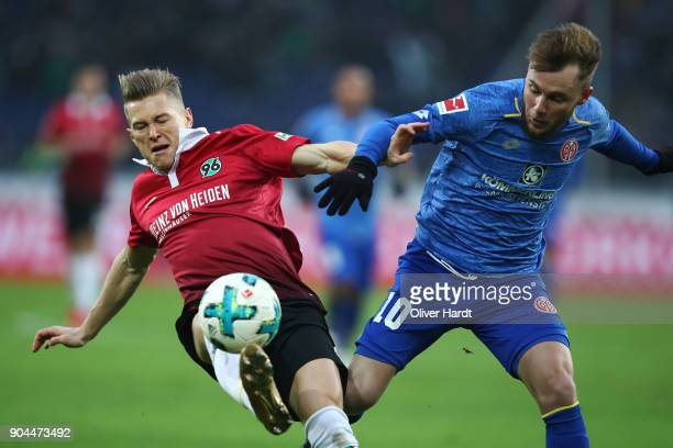 Matthias Ostrzolek of Hannover and Alexandru Maxim of Mainz compete for the ball during the Bundesliga match between Hannover 96 and 1 FSV Mainz 05...