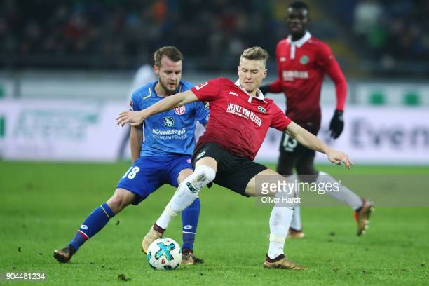 Matthias Ostrzolek of Hannover and Daniel Brosinski of Mainz compete for the ball during the Bundesliga match between Hannover 96 and 1 FSV Mainz 05...