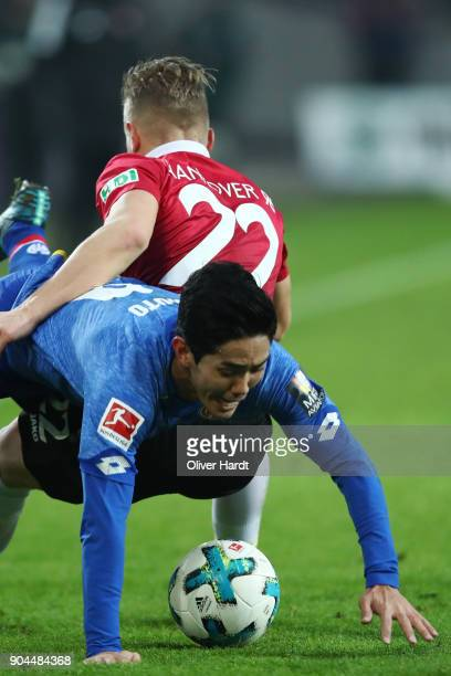 Matthias Ostrzolek of Hannover and Yoshinori Muto of Mainz compete for the ball during the Bundesliga match between Hannover 96 and 1 FSV Mainz 05 at...