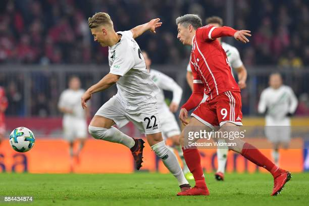 Matthias Ostrzolek of Hannover is chased by Robert Lewandowski of Bayern Muenchen during the Bundesliga match between FC Bayern Muenchen and Hannover...