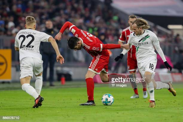 Matthias Ostrzolek of Hannover Iver Tobias Rorvik Fossum of Hannover and Javier Martinez of Bayern Muenchen battle for the ball during the Bundesliga...