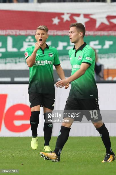 Matthias Ostrzolek of Hannover pumps his fist during the Bundesliga match between FC Augsburg and Hannover 96 at WWKArena on October 21 2017 in...