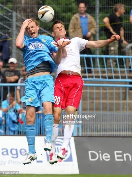 Matthias Pessolat of Chemnitz and Stefan Kutschke of Leipzig jump for a header during the Regionalliga North match between Chemnitzer FC and RB...