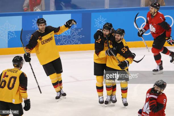 Matthias Plachta of Germany celebrates with Felix Schutz after scoring in the second period against Canada during the Men's Playoffs Semifinals on...