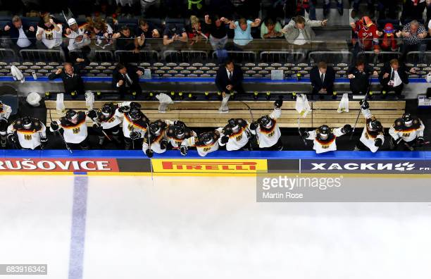 Matthias Plachta of Germany celebrates with team mates after the 2017 IIHF Ice Hockey World Championship game between Germany and Latvia at Lanxess...