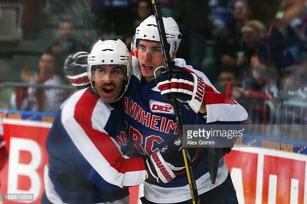 Matthias Plachta of Mannheim celebrates his team's second goal with team mate Marc ElSayed during the DEL match between Adler Mannheim and Koelner...