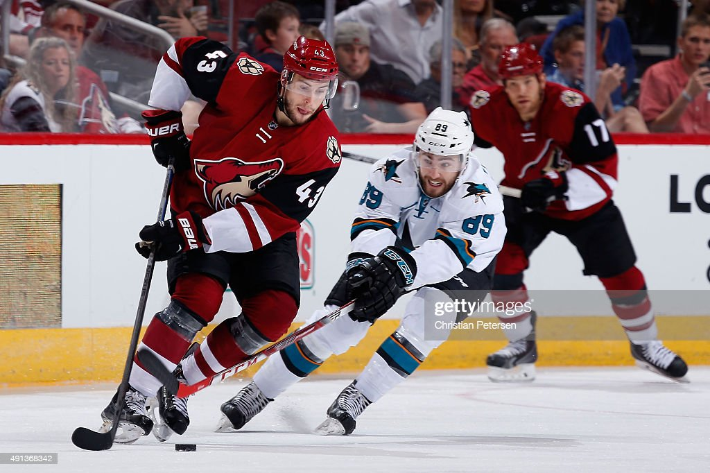Matthias Plachta #43 of the Arizona Coyotes skates with the puck under pressure from Barclay Goodrow #89 of the San Jose Sharks during the NHL preseason game at Gila River Arena on October 2, 2015 in Glendale, Arizona.