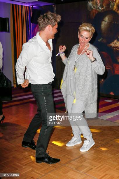 Matthias Pridoehl and Claudia Effenberg dacne during the Kempinski Fashion Dinner on May 23, 2017 in Munich, Germany.