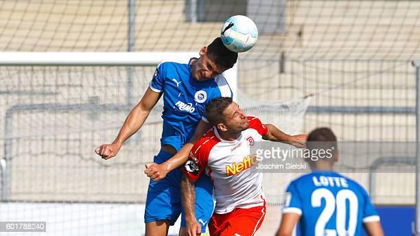 Matthias Rahn of Lotte challenges Marco Gruettner of Regensburg during the third league match between Sportfreunde Lotte and Jahn Regensburg at Frimo...