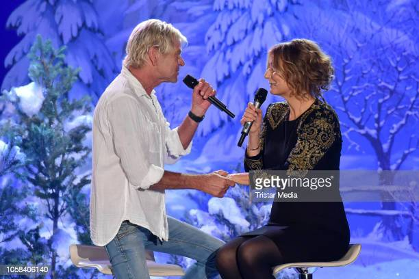 Matthias Reim and Kim Fisher perform the taping of the MDR TV show 'Weihnachten bei uns' at Stadthalle on November 6, 2018 in Zwickau, Germany. The...