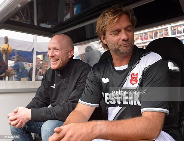 Matthias Sammer manager of FCbayern Muenchen and Juergen Klopp head coach of Borussia Dortmund talk together during the day of the legends event at...